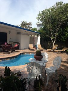 House one minute from a beach, heated pool with a kids safety automatic cover.