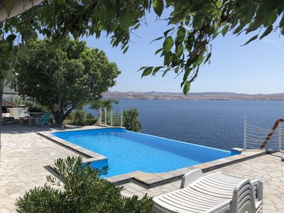 Photo for A1 - Right on the private beach with swiming pool, tennis court, biliar, salon