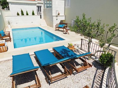 Photo for This 4-bedroom villa for up to 10 guests is located in Baska Voda and has a private swimming pool, a