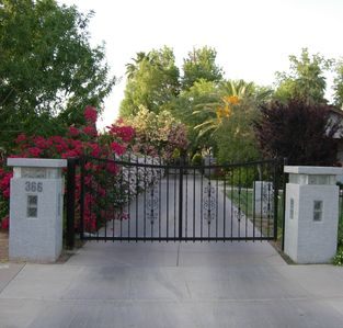 A private entrance leads  to a lush, green, urban retreat in the desert. WELCOME