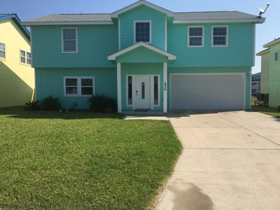 Photo for Coastal Serenity awaits you in the Heart of Port Aransas. Short walk to beach!