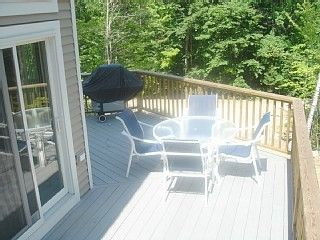 wrap around deck with patio furniture & gas grill
