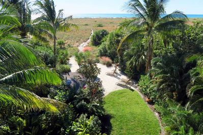 Lush landscaping with your own private path to the beach.