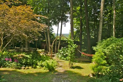 Stone path leading to the hammock and guest house.