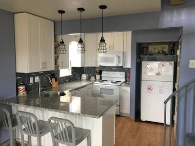 NEWLY RENOVATED fully stocked open view kitchen with full size appliances!