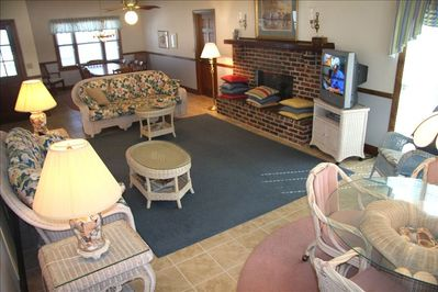 The large Living area flows from the game table, Living Area & Dining table.