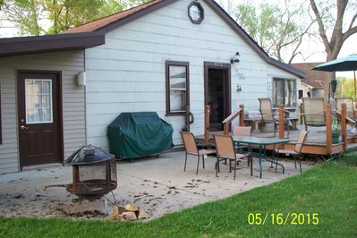 Private Concrete patio w/ outdoor fire place and natural gas grill.