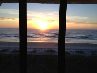 Morning sunrise from Living room through full wall floor to ceiling windows.