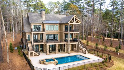 Photo for Luxurious NEW 2019 5 Bedroom Lakefront Home April 1-15. 2021
