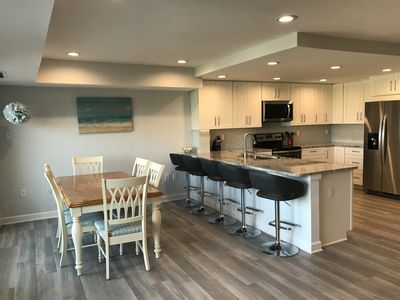 Photo for LINENS & DAILY ACTIVITIES INCLUDED!  OCEANFRONT/BOARDWALK BUILDING W/ ROOFTOP POOL Completely remodeled kitchen with all-new cabinets and appliances, open floor plan and eat-at counter.