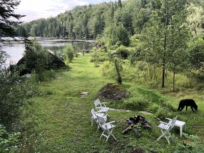 Photo for 3 bedroom ski condo with attached garage overlooking a lake and small waterfall.