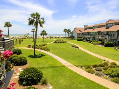 Photo for This villa is on the second story of a horseshoe shaped group of villas overlooking a large green space, with the beach and ocean just steps away  Please ask us about Golf Packages for Monthly Rentals!!!!