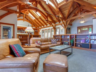 Photo for Beautiful lakefront lodge w/ views, private beach access, & large deck!