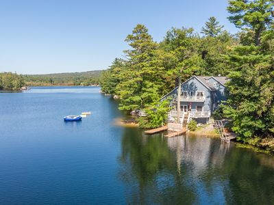 Photo for Stunning waterfront home offers lake fun for the entire family