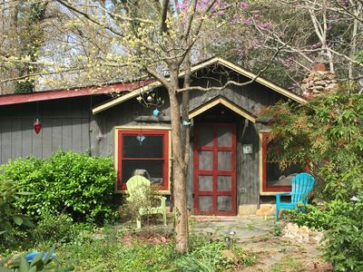 Springtime Dodwood and Redbud trees embrace our little cabin