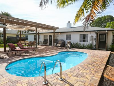Photo for 3/3 private home with pool, steam sauna and fenced in tropical backyard