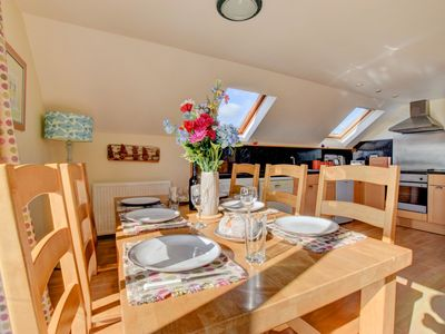 Photo for With panoramic sea views, this light, airy and spacious cottage is the perfect location for your Pem