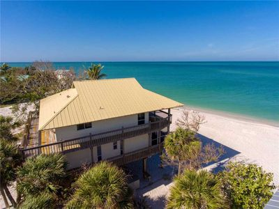 Photo for ENCHANTING PRISTINE BEACHFRONT HOME WITH REMARKABLE VIEWS OF THE GULF