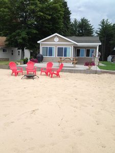 Photo for Sandy beach and beautiful sunsets over Lake Missaukee!