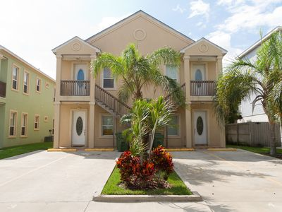 Photo for Skip hotel & high prices, stay in a bigger condo with a complete kitchen & pool! Close to the Beach!