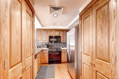 Prepare your meals in the fully-equipped kitchen featuring all modern appliances