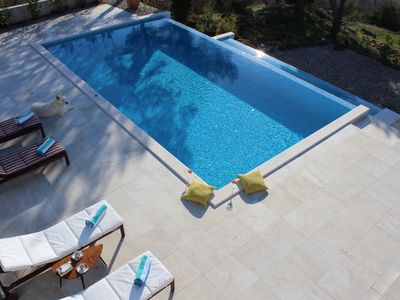Photo for Beautiful Villa with Panoramic Sea View and Heated Pool, 5 minutes from beach