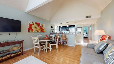 Photo for Upscale snowbird friendly condo w/ shared pools, hot tub, & more - beach nearby!