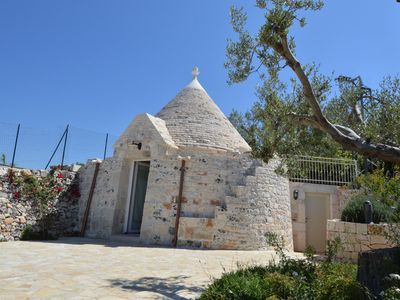 Photo for Romantic trullo with terrace and pool in the Itria Valley