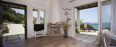Sun Villa - main entrance, living room with fireplace and front terrace