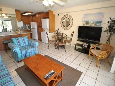 Large flat screen tv and dining room table