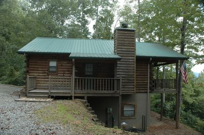 Log home with tin roof only 2 steps to the main level.