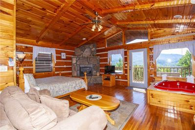 Your Modern-Day Log Cabin - Smooth polished wood, stone fireplace, comfy bed, and lots of windows combine to make Love Me Tender the perfect bear's den for your Gatlinburg getaway!