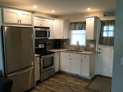 Shaker cabinets, granite counters, and stainless appliances in kitchen