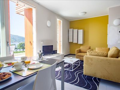 Photo for Colorful 2bdr with external patio on Iseo Lake