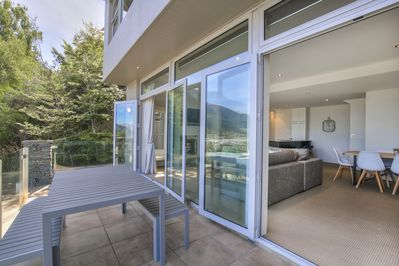 Two sets of double sliding doors open from the lounge and dining areas to your spacious private balcony.