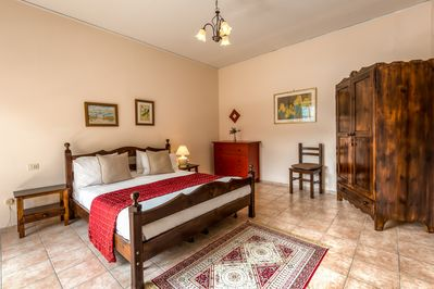 Romantic master bedroom w/French doors to your private balcony & lake views.