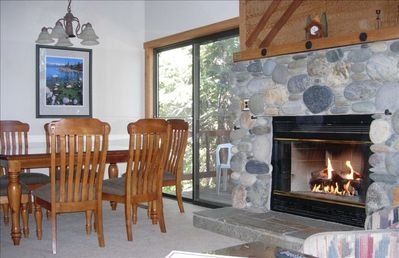 Enjoy the view as the fireplace warms the Living Room & Dining Room.