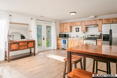 Spacious and bright kitchen with dining room.
