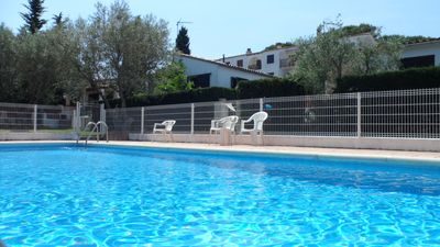 Photo for Apartment with community pool, with two bedrooms (one with double bed and one with single