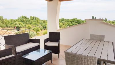 Photo for Beautiful three-room apartment with veranda overlooking the sea in the center of Budoni