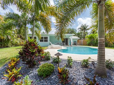 Photo for Downtown chic beach house with heated saltwater pool