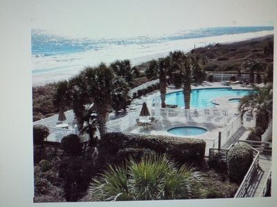 View of outdoor pool, hottub and ocean