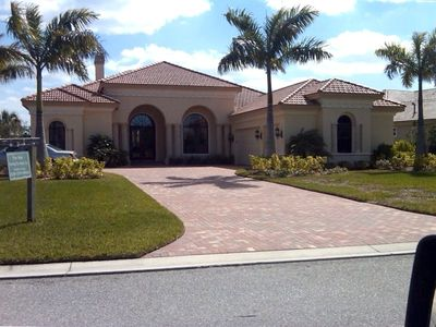 Front Elevation. 2 car + Golf Cart Garage <One Mile from Golf Staging-club hous