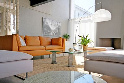 The open plan lounge with fireplace