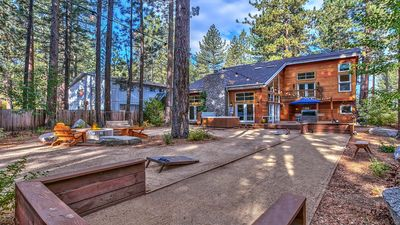 Enormous backyard with fire pit, hot tub, bocce court, string lights