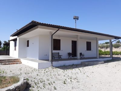 Photo for Villa near the sea with large garden and stone barbecue.