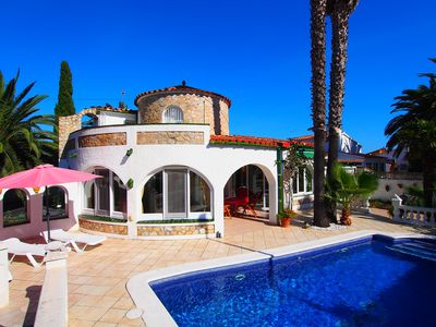 Photo for This 3-bedroom villa for up to 7 guests is located in Empuriabrava and has a private swimming pool,