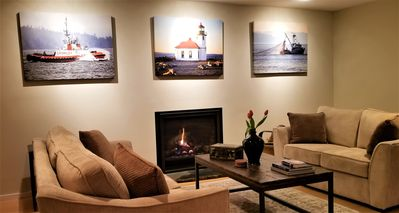 Great room featuring gas fireplace, art by PNW photographer Cole Golpnenee .