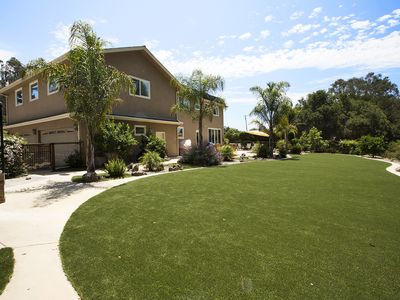 Photo for Family Getaway!! Huge Private Backyard, Hot Tub, Pet Friendly & Beach's close by
