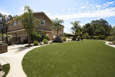 Backyard: 1500 sq. feet of artificial lawn and 1000 of cement patio